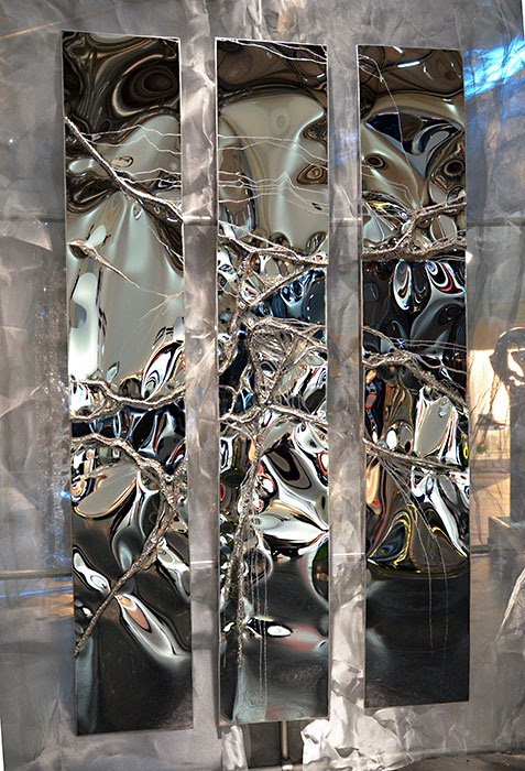 welded wall sculpture | mirror polished stainless steel